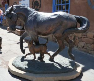 bronze statue of dog and horse