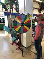 person standing in front of a spinwheel