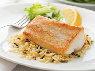 baked fish on a bed of brown rice