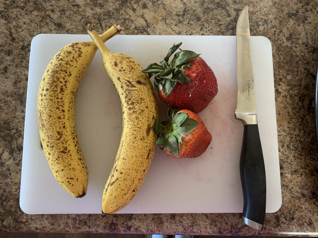 2 bananas 2 strawberries knife
