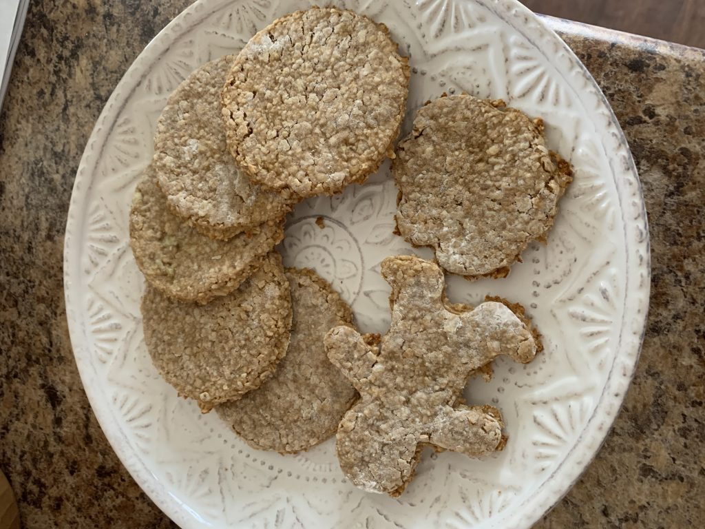 banana peanut butter oat cookies on a white plate