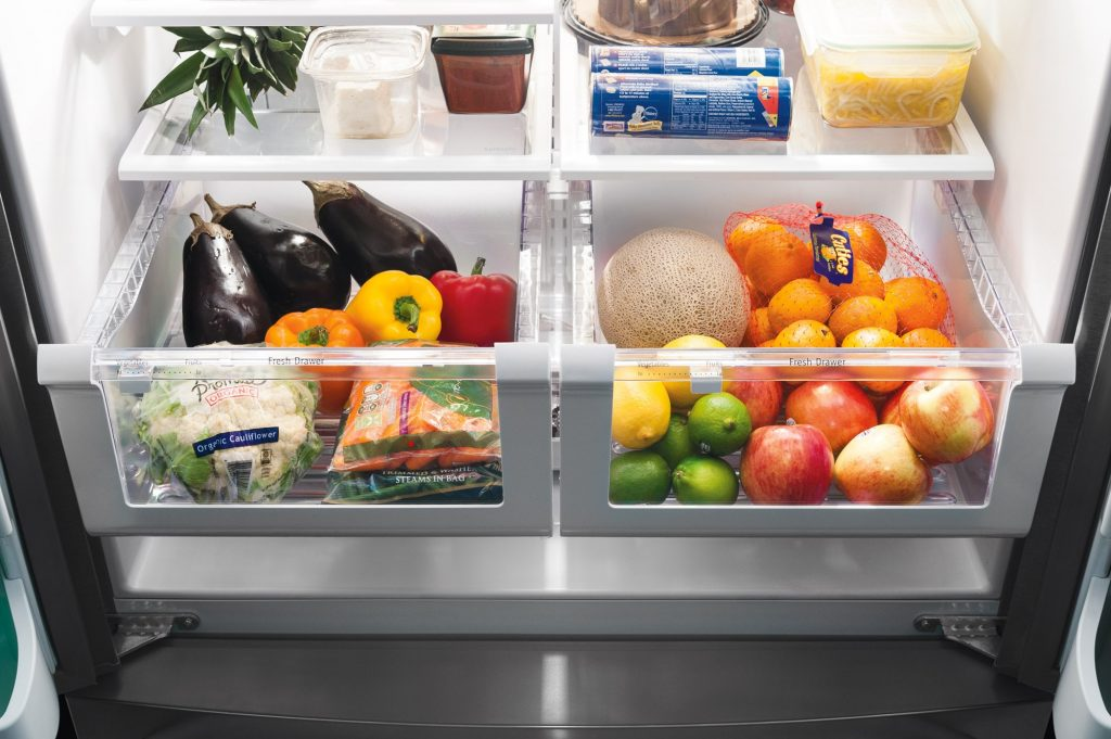 crisper drawers with eggplant bell peppers cantaloupe oranges limes apples