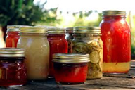 seven jars of home canned items - tomatoes pickles jelly