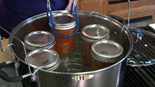 five jars in a waterbath canner